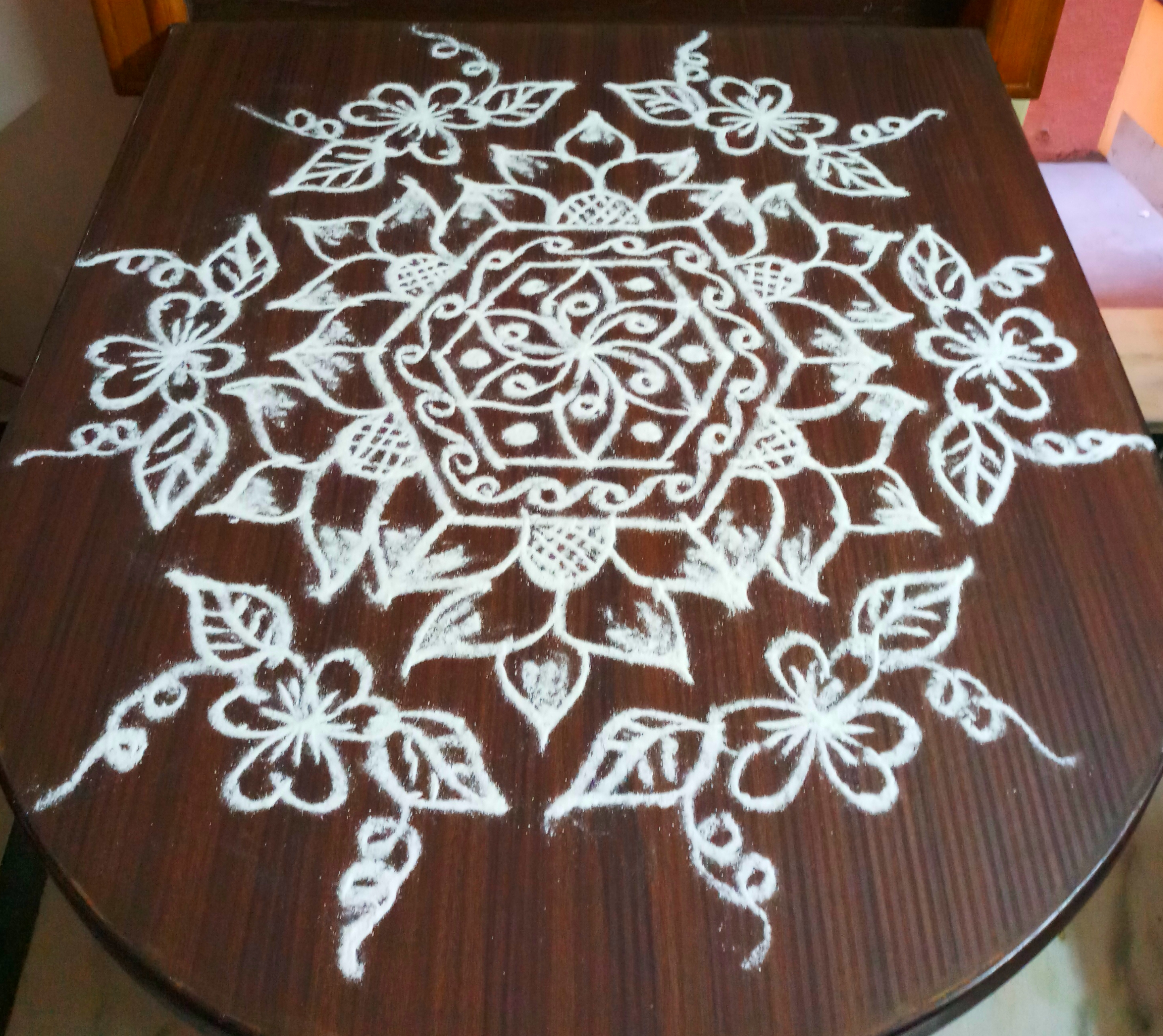 Flower kolam with 15 dots