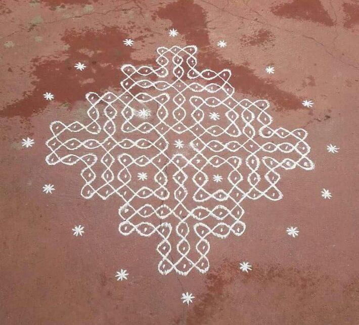 Twinkling stars around sikku kolam with 15 dots