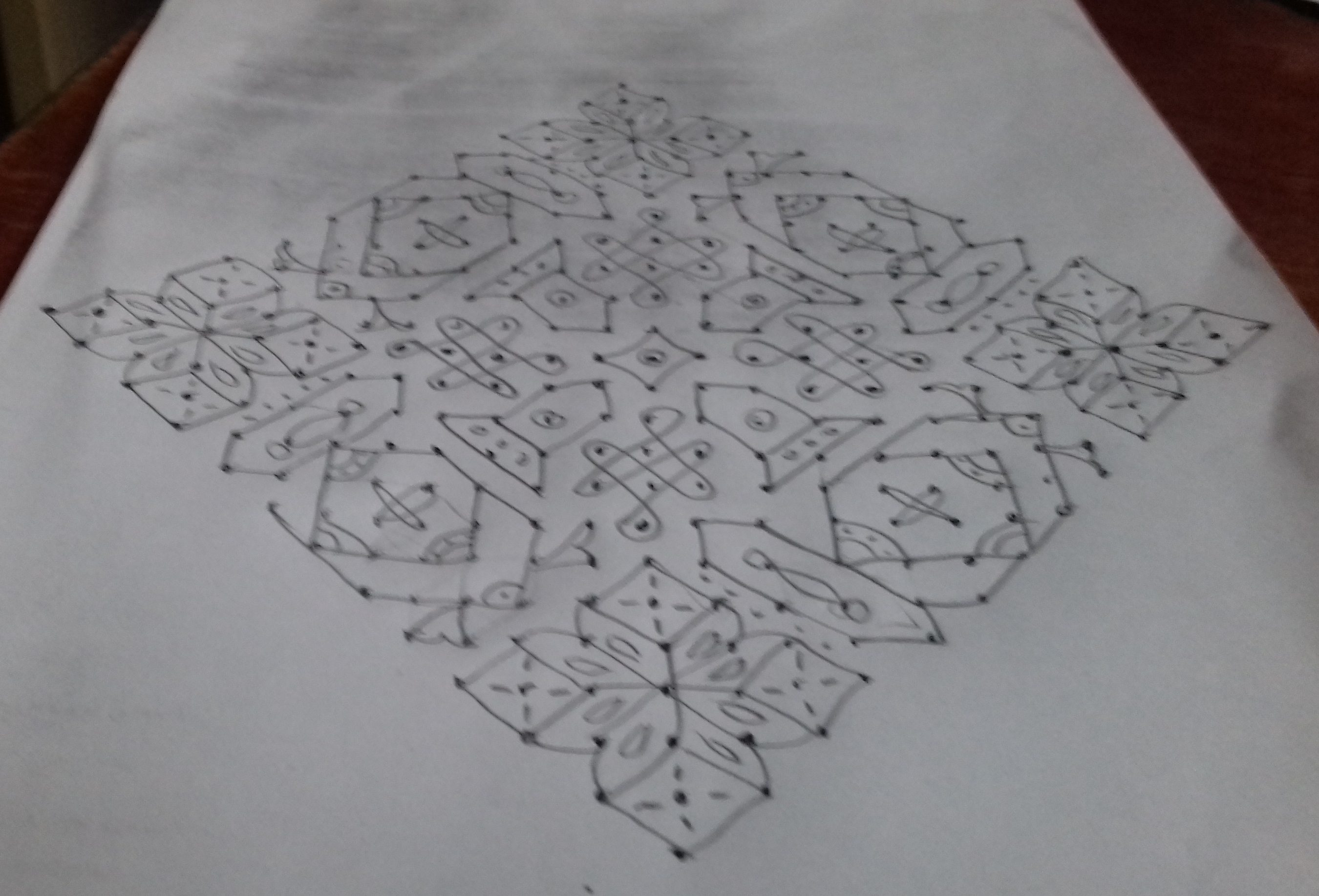 Design with small chikku kolam    25 Dots contest Kolam