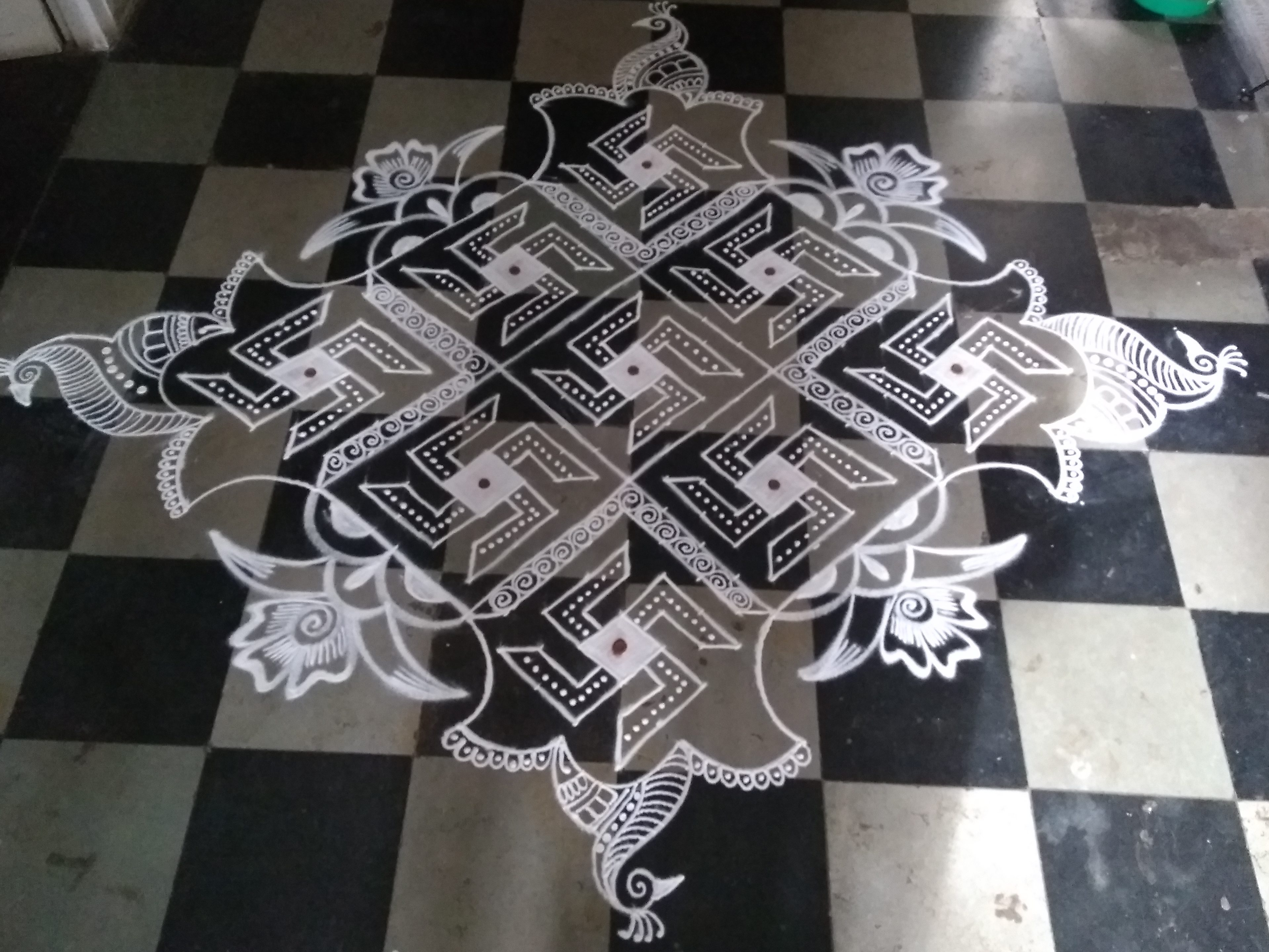 Line kolam decorated by borders    25 dots Swasthik Kolam for contest
